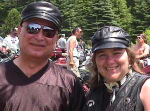 Picture of 2 happy folks at the 1999 Blessing of the Bikes and link to that section of the web site.